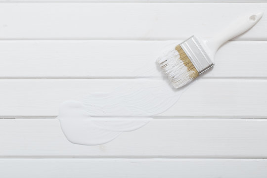 Paint Brush on a white Wood background