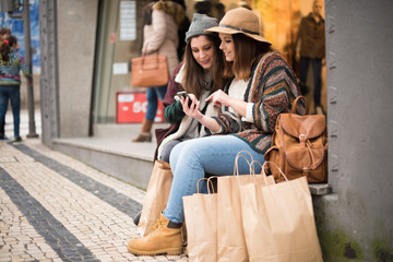 Girls with a smartphone in the city