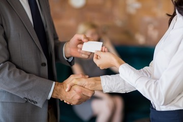 Business colleagues exchanging business card
