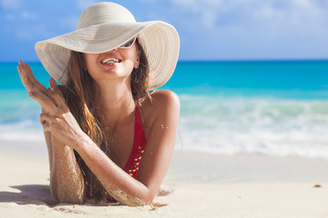 portrait of glamorous long haired woman at beach