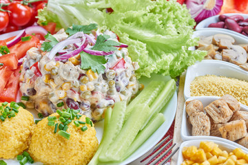 Chicken and vegetable salad on a white plate. Salad ingredients
