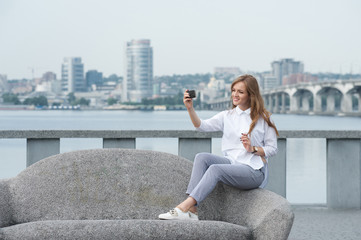 trendy young woman taking a selfie in the city02