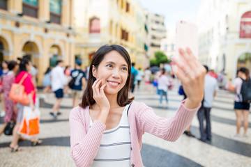 Woman taking selfie in Senado Square of Macao