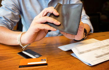 credit card debt - pour empty wallet.