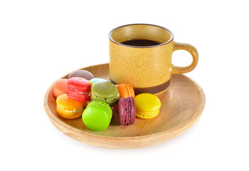 mini colorful macaroons with a cup of black coffee on wooden pla