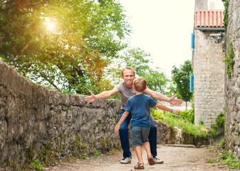 Son runs to his daddy hugs