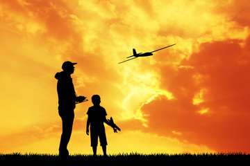 man and child with a airplane model remote control