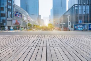 Fototapete - empty wooden floor with modern building in city