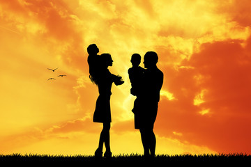 parents with children at sunset