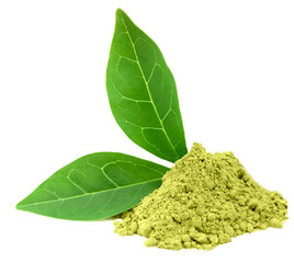 Green  powder matcha tea with green leaves isolated on white
