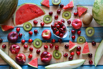 rustic table full of pieces of watermelon, melon