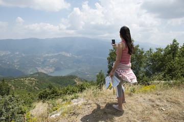 Woman taking pictures with smartphone