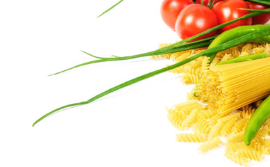 Wall Mural - different types of raw italian pasta with vegetables and spices isolated on white background close up