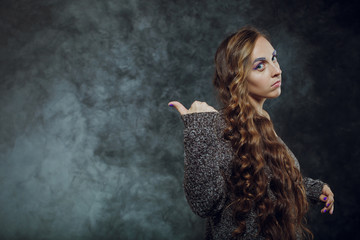 Portrait of a beautiful woman with long hair. Space for text