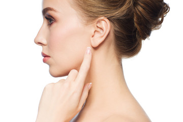beautiful woman pointing finger to her ear