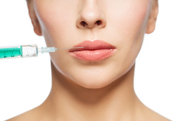 woman face and syringe making injection