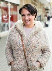 brunette in outerwear on street