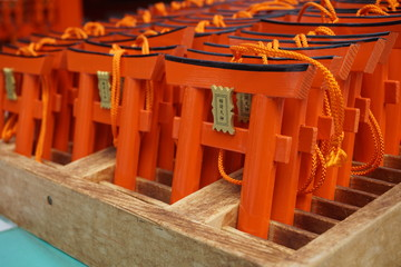 Number of tiny orange traditional Japanese gates (miniatures of Toriis) in the Shinto shrines  as a symbolical mark of the transition from the profane to   the sacred
