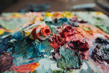Artists oil paints on wooden palette.