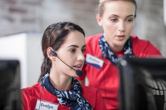 Two female telephonists working in call centre