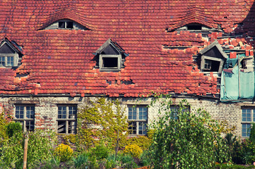 Old orange brick roof with retro windows