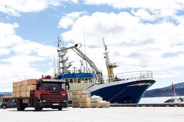 trabsportation ship and truck with blue sky.