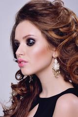 Beautiful young model with bright makeup and sunburn skin Evening make up, night, sunburn skin