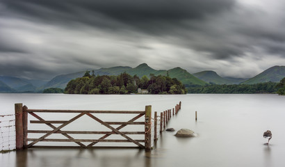 Moody dramatic blurred clouds over Derwentwater lake in the Lake District.