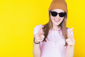 Young teenager wearing a hat and sunglasses