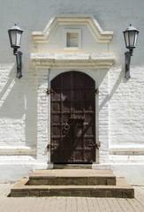 Old wooden door stone wall