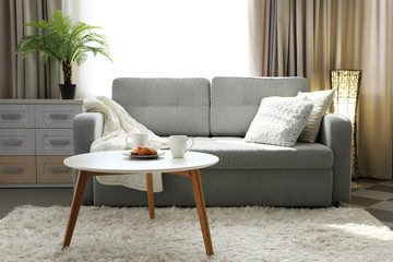 Living room design interior with sofa and round table