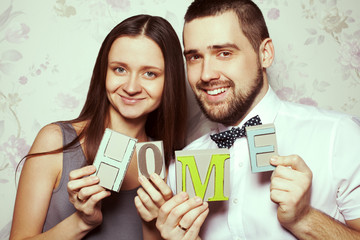 Housewarming party concept. Portrait of funny smiling hipster couple