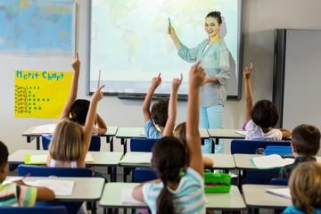 Teacher teaching schoolchildren using projector screen