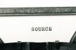 word source typed on typewriter