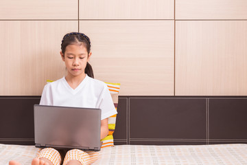 Happy asian girl using computer laptop notebook