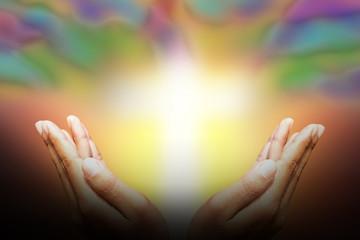 Concept believe.Human hands protecting  light cross the sky.