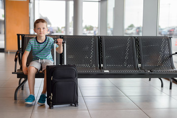 Child boy waiting in waiting room for passengers