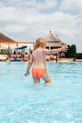 Child in the shallow pool