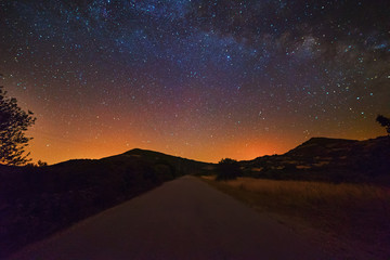 starry sky over a country road