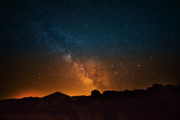 milky way over the countryside