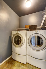 Laundry room with tile floor, washer, and dryer.