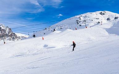 Skier on the slopes of the ski resort of Meribel, France