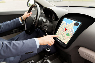 close up of man driving car with gps navigator map