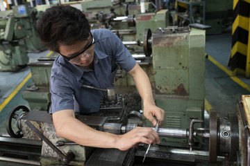 technician checking for workpiece steel on machine
