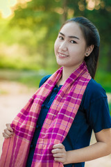 Asian woman in countryside of Thailand.Women wearing traditional dresses.