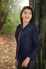 Beauty Asian country girl smilling on field.