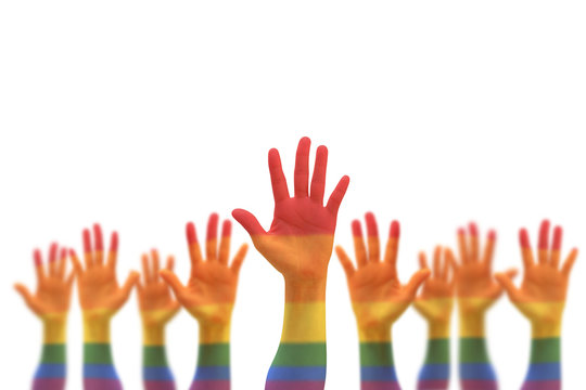Rainbow multi-color flag pattern on blur many people human hands raising upward isolated on white background (clipping path)