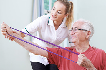 Senior Male Working With Physiotherapist