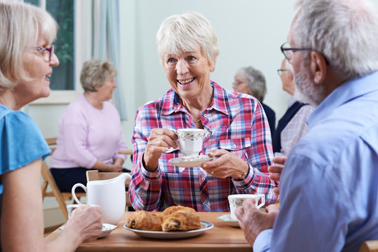 Group Of Seniors Meeting At Social Club