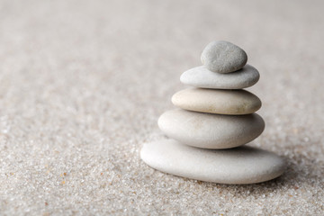 Japanese zen garden meditation stone for concentration and relaxation sand and rock for harmony and balance in pure simplicity - macro lens shot Wall mural